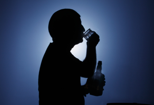 Man drinking alcohol. Silhouette.