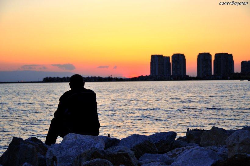 a_lonely_guy_watching_sundown_by_svenng-d3g1uu4